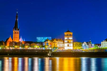 Night view of riverside of Rhein in Dusseldorf with Saint Lambertus church, Germany