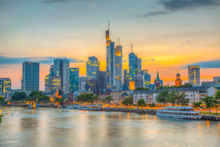 Sunset view of skyscrapers alongside river Main in Frankfurt, Germany Stock Photo