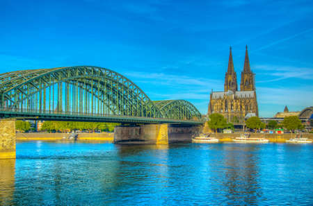 Cathedral in Cologne and Hohenzollern bridge over Rhein, Germany Banque d'images - 129553544
