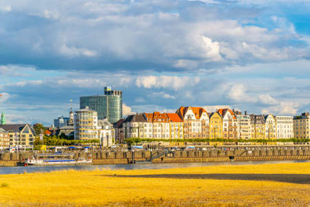 Colorful houses at riverside promenade in Dusseldorf, Germany Stock Photo
