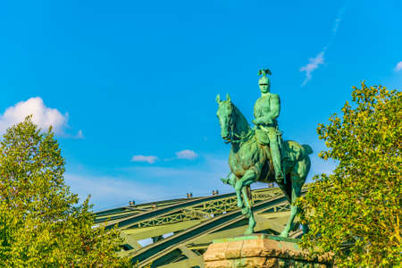 Hohenzollern bridge behind statue of emperor Wilhelm II in cologne, Germany Reklamní fotografie