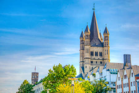 Colorful facades and spire of the Saint martin church in cologne, Germany Imagens