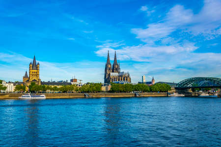 Cityscape of Cologne with Hohenzollern bridge, cathedral and Saint Martin church, Germany 版權商用圖片