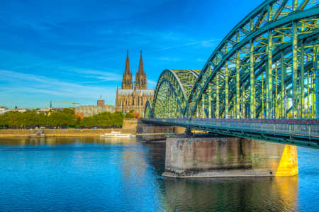 Cathedral in Cologne and Hohenzollern bridge over Rhein, Germany