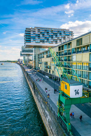 COLOGNE, GERMANY, AUGUST 11, 2018: people are admiring Kranhaus building complex on riverside of Rhein in Cologne, Germany Editorial