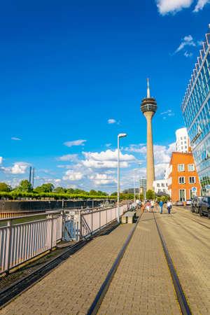 DUSSELDORF, GERMANY, AUGUST 10, 2018:  People are walking towards the Rheinturm in Dusseldorf, Germany