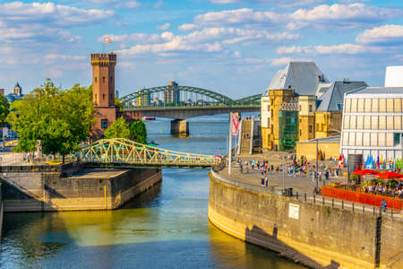 COLOGNE, GERMANY, AUGUST 11, 2018: People are passing between Malakoffturm tower and Chocolate museum in Cologne, Germany Redactioneel