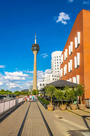 DUSSELDORF, GERMANY, AUGUST 10, 2018:  People are walking towards the Rheinturm in Dusseldorf, Germany