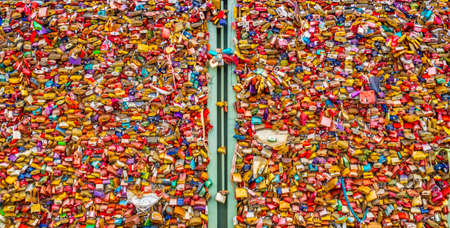 COLOGNE, GERMANY, AUGUST 11, 2018: Detail of love locks on Hohenzollern bridge in Cologne , Germany