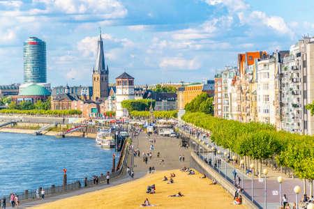 DUSSELDORF, GERMANY, AUGUST 10, 2018: Riverside of Rhein in Dusseldorf with Saint Lambertus church, Germany Redakční