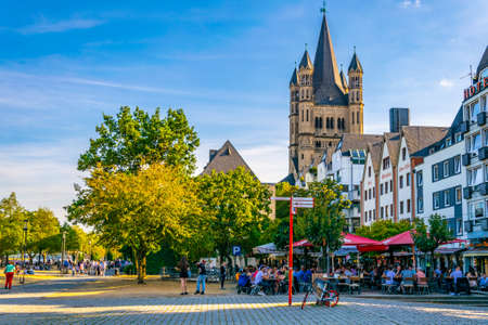 COLOGNE, GERMANY, AUGUST 11, 2018: Riverside promenade and Saint Martin church in Cologne, Germany Editorial