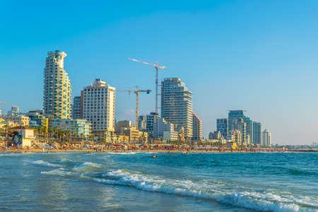 TEL AVIV, ISRAEL, SEPTEMBER 10, 2018: People are enjoying a sunny day on a beach in Tel Aviv, Israel