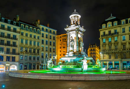 LYON, FRANCE, JULY 22, 2017: Night view of a beautiful marble fountain on Place des Jacobins in Lyon, France