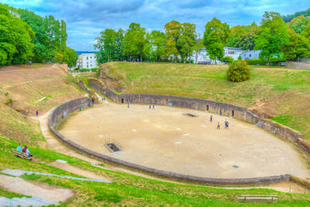 TRIER, GERMANY, AUGUST 14, 2018: People strolling through old roman amphitheater in Trier, Germany