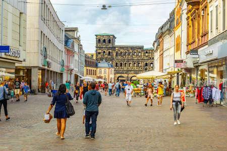 TRIER, GERMANY, AUGUST 14, 2018: People strolling towards Porta Negra in trier, Germany