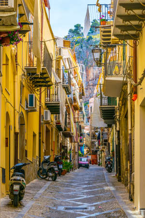 View of a narrow street in Cefalu, Sicily, Italy