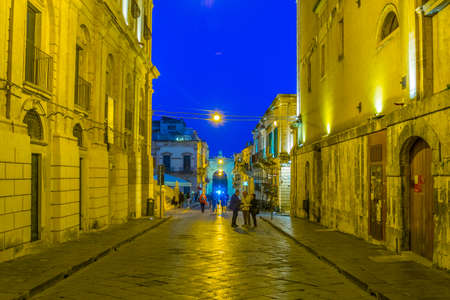 NOTO, ITALY, APRIL 25, 2017: Sunset view of the corso Vittorio Emanuele in Noto, Sicily, Italy