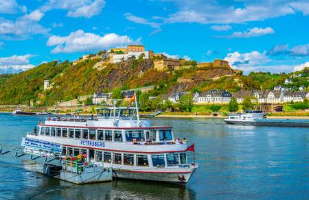 KOBLENZ, GERMANY, AUGUST 13, 2018: Ehrenbreitstein fortress in Koblenz viewed behind a tourist boat, Germany