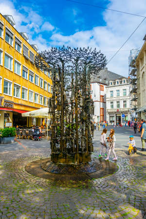 TRIER, GERMANY, AUGUST 14, 2018: People strolling through a narrow street in trier, Germany