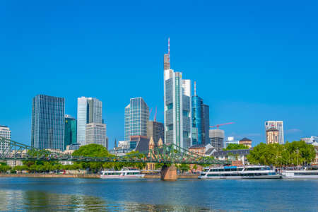 FRANKFURT, GERMANY, AUGUST 18, 2018: Skyscrapers in frankfurt viewed behind church of saint leonhard, Germany