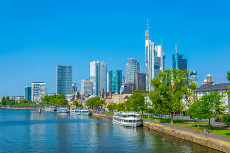 FRANKFURT, GERMANY, AUGUST 18, 2018: Skyscrapers alongside river Main in Frankfurt, Germany