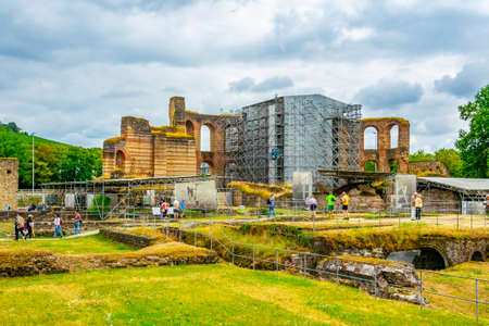 TRIER, GERMANY, AUGUST 14, 2018: People strolling through ruins of Kaiserthermen in Trier, Germany 報道画像