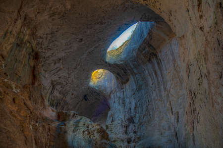 Prohodna cave in Bulgaria famous for the God's eyes holes in the ceiling