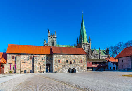 Nidaros cathedral viewed from courtyard of archbishop's palace in Trondheim, Norway