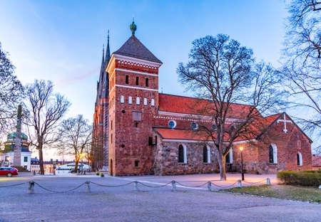 Susnset view of Helga Trefaldighets kyrka and cathedral in Uppsala, Sweden Stock fotó