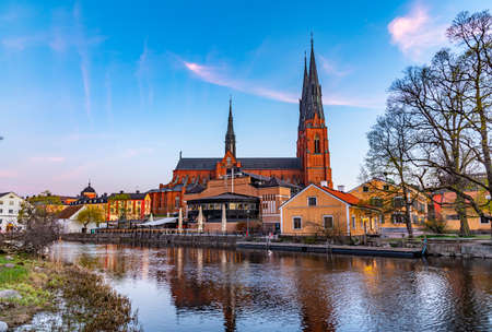 Sunset view of Uppsala cathedral reflecting on river Fyris in Sweden Stock fotó