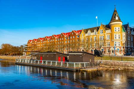 Residential buildings alongside river Gavlean in Gavle, Sweden