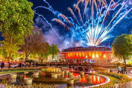 Midnight fireworks over the Concert hall at Tivoli amusement park in Copenhagen,Denmark.
