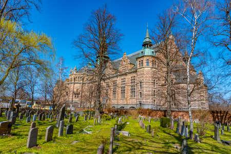 Nordiska museet behind a cemetary in Stockholm, Sweden Редакционное