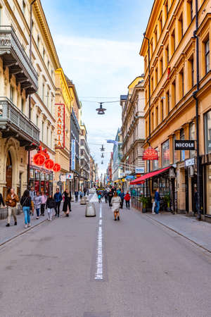 STOCKHOLM, SWEDEN, APRIL 21, 2019: People are strolling through a busy street in central Stockholm, Sweden