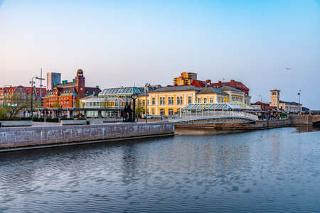 MALMO, SWEDEN, APRIL 24, 2019: Sunset view of waterfront alongside a channel in Malmo, Sweden 版權商用圖片