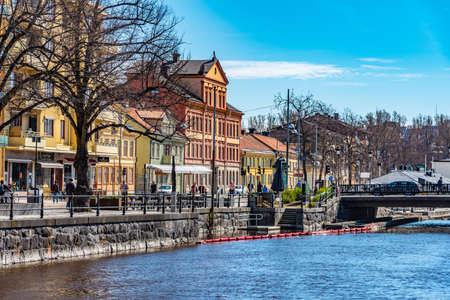 UPPSALA, SWEDEN, APRIL 22, 2019: Notable buildings alongside river Fyris in Uppsala, Sweden