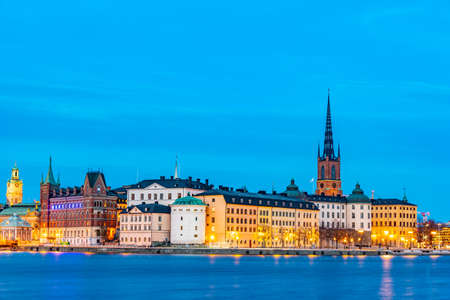 STOCKHOLM, SWEDEN, APRIL 21, 2019: Sunset view of Gamla Stan old town dominated by Riddarholmskyrkan church in Stockholm, Sweden