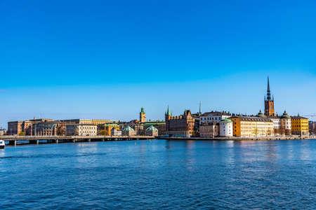 STOCKHOLM, SWEDEN, APRIL 20, 2019: Gamla Stan old town dominated by Riddarholmskyrkan church in Stockholm, Sweden
