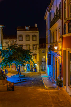 COIMBRA, PORTUGAL, MAY 20, 2019: Night view of a narrow street at the old town of Coimbra, Portugal Stock Photo