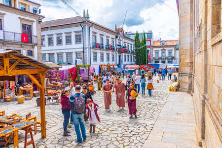 BRAGA, PORTUGAL, MAY 23, 2019: People are passing among traditional stands during Braga Romana festival reminding roman heritage of the city of Braga, Portugal