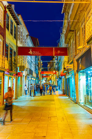 BRAGA, PORTUGAL, MAY 22, 2019: People are strolling through narrow street of historical center of Braga, Portugal Stock Photo