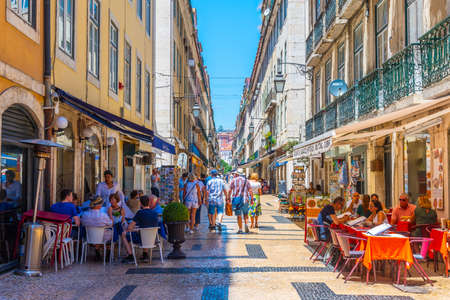 LISBON, PORTUGAL, JUNE 1, 2019: People are strolling on street leading to Praca do Comercio in Lisbon, Portugal