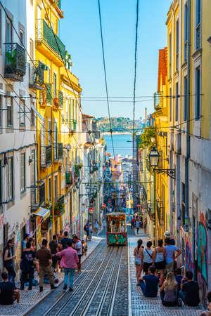 LISBON, PORTUGAL, JUNE 1, 2019: People are waiting for Elevador la Bica tram in Lisbon, Portugal 版權商用圖片