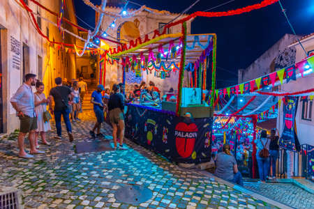 LISBON, PORTUGAL, MAY 31, 2019: People are enjoying a street food festival at Alfama district in Lisbon, Portugal