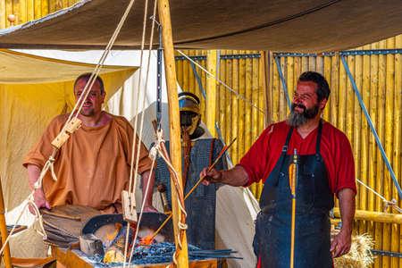 BRAGA, PORTUGAL, MAY 23, 2019: Reconstruction of roman workshops during Braga Romana festival in Portugal