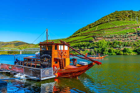 PINHAO, PORTUGAL, MAY 26, 2019: Cruise ship on Douro river passing among vineyards, Porto