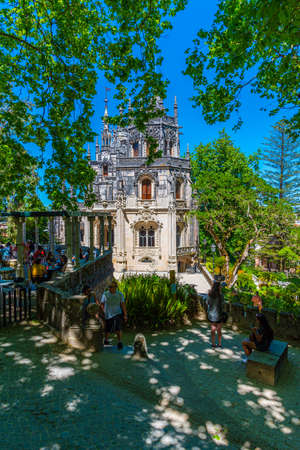 SINTRA, PORTUGAL, MAY 30, 2019: People are strolling through grounds of Quinta da Regaleira palace in Sintra, Portugal