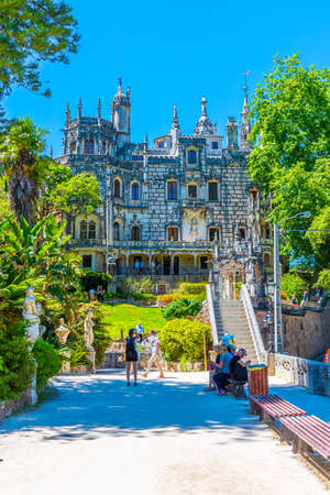 SINTRA, PORTUGAL, MAY 30, 2019:  People are strolling through grounds of Quinta da Regaleira palace in Sintra, Portugal Фото со стока - 136573911