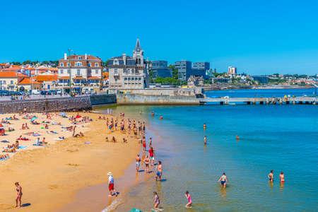 CASCAIS, PORTUGAL, MAY 31, 2019: Seixas palace viewed behind Praia dos Pescadores beach in Cascais, Portugal