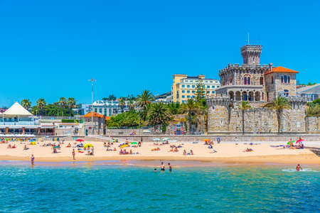 ESTORIL, PORTUGAL, MAY 31, 2019: People are strolling in front of the Estoril Castle in Portugal